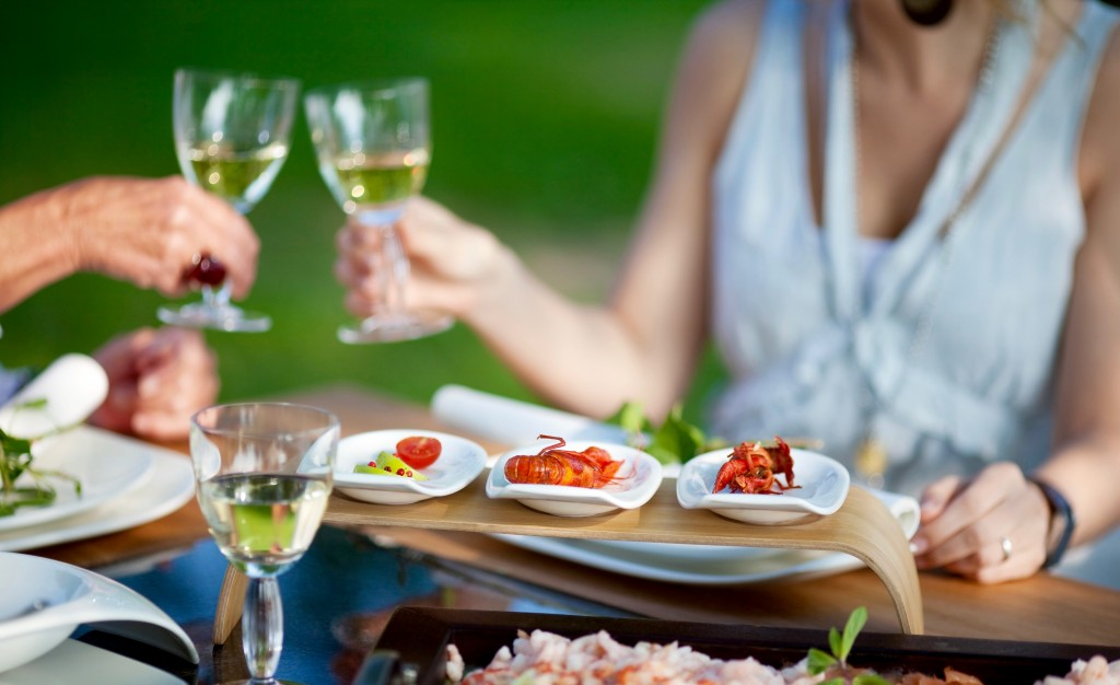 people at dining table in the garden toasting with wine Rouen normandy
